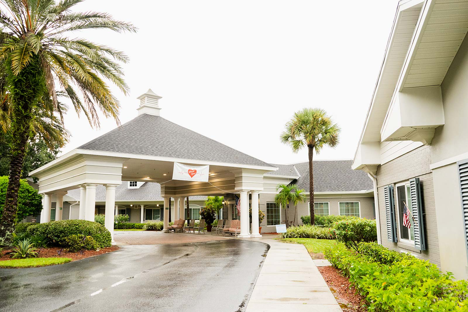 Front entrance to The Colonnade at Northdale assisted living and memory care community in Tampa, FL