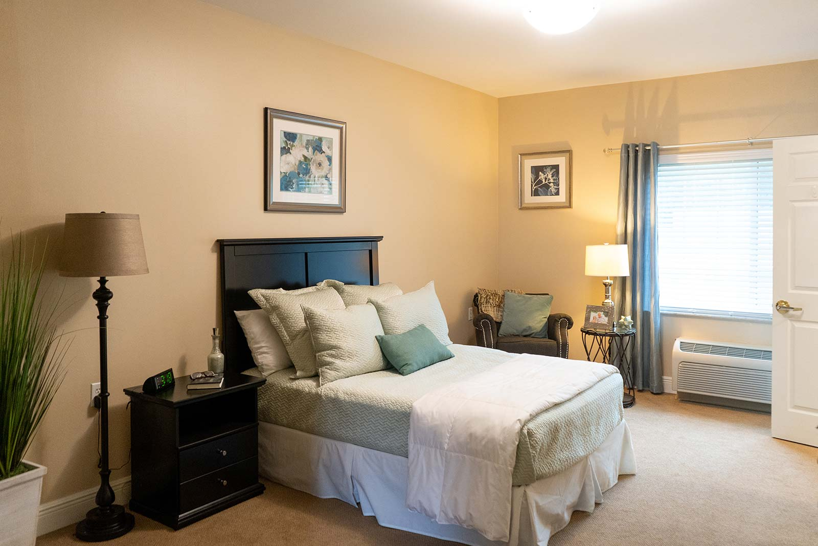 Assisted living apartment bedroom at The Colonnade at Northdale in Tampa, FL